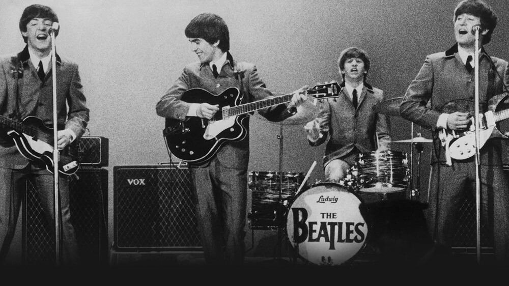 The Beatles Playing instruments
